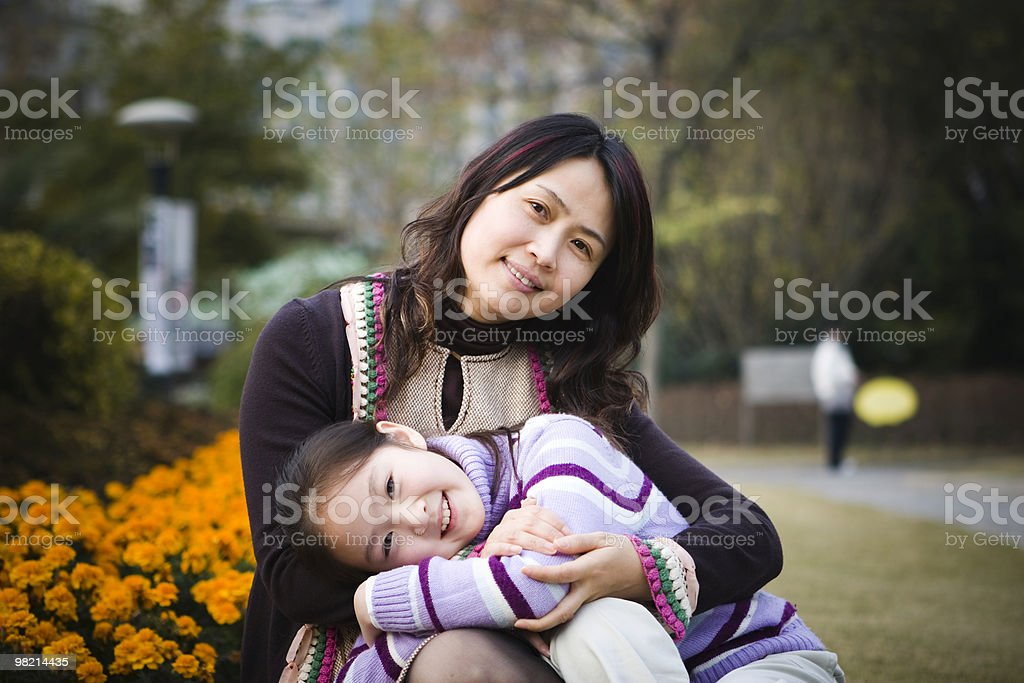 Portrait of mother and daughter in a park royalty-free stock photo