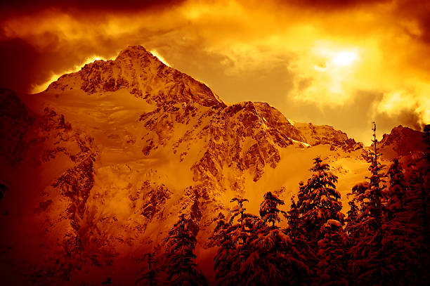 Portrait of Mountains and Forest Covered in Snow, Red Toned stock photo