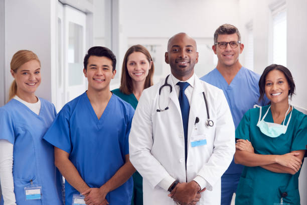 Portrait Of Multi-Cultural Medical Team Standing In Hospital Corridor stock photo