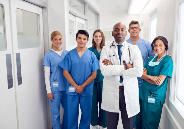 Portrait Of Multi-Cultural Medical Team Standing In Hospital Corridor stock photo