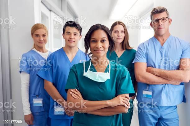 Portrait of multicultural medical team standing in hospital corridor picture id1204177269?b=1&k=6&m=1204177269&s=612x612&h=q1gsfn5ckagcl7efrl3nefam fczkkz4btvmapputnw=
