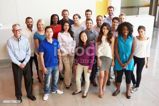 istock Portrait Of Multi-Cultural Office Staff Standing In Lobby 469578809