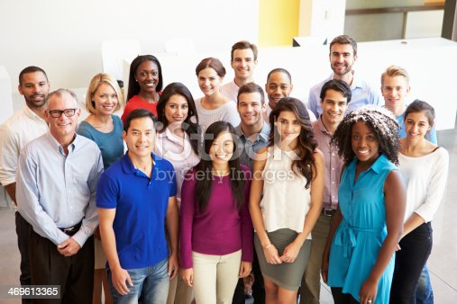 istock Portrait Of Multi-Cultural Office Staff Standing In Lobby 469613365