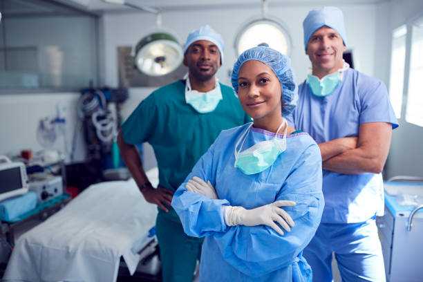 Portrait Of Multi-Cultural Surgical Team Standing In Hospital Operating Theater stock photo