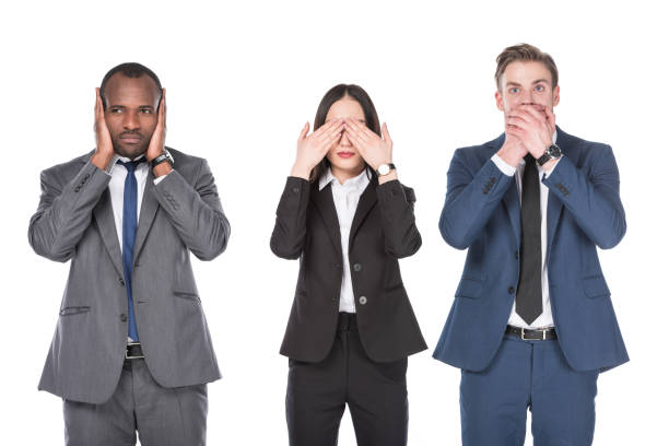 portrait of multicultural young business people covering parts of faces isolated on white portrait of multicultural young business people covering parts of faces isolated on white hear no evil stock pictures, royalty-free photos & images