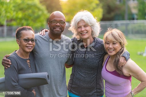 istock Portrait of multi-ethnic group of seniors attending outdoor fitness class 1173387686