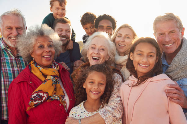 Portrait Of Multi-Generation Family Group On Winter Beach Vacation Portrait Of Multi-Generation Family Group On Winter Beach Vacation multi ethnic group stock pictures, royalty-free photos & images