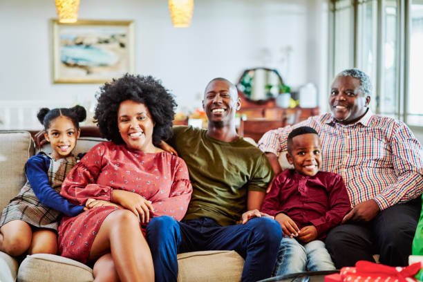 Portrait of multi-generation family sitting at home stock photo
