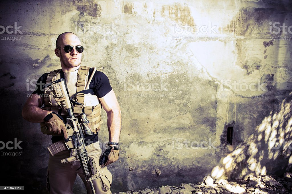 Portrait of Muscled Handsome Modern Hero Holding Automatic Rifle stock photo