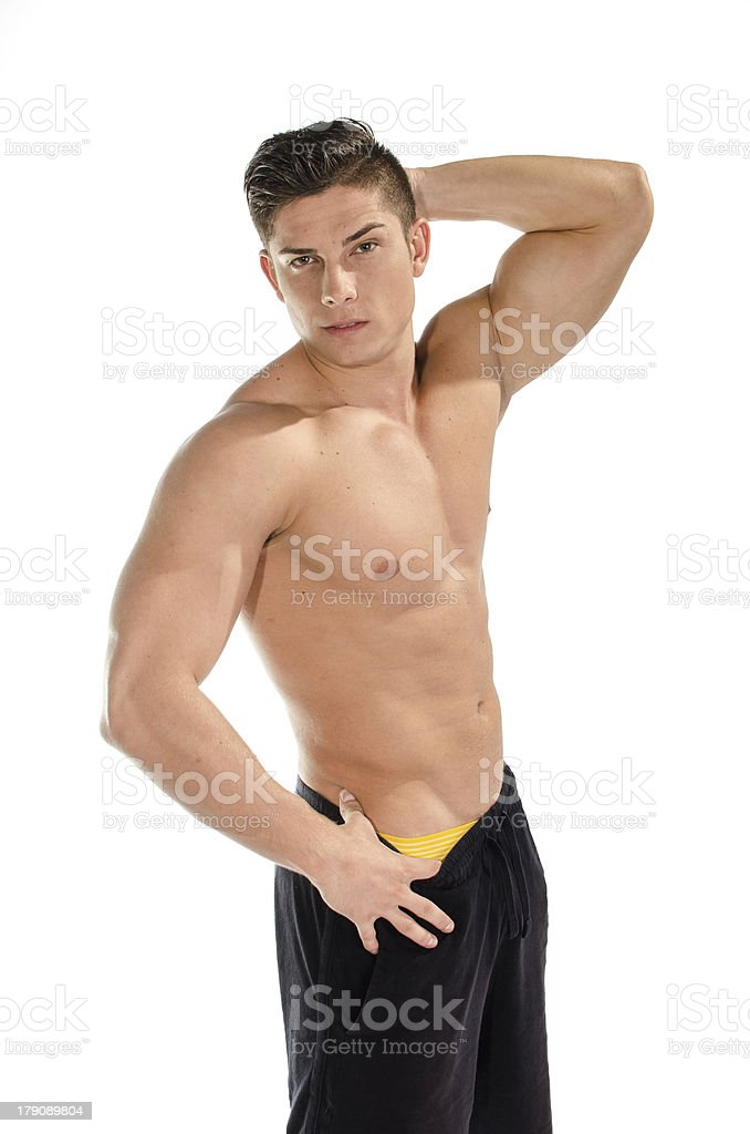 Portrait of muscular man standing with hand behind head royalty-free stock photo
