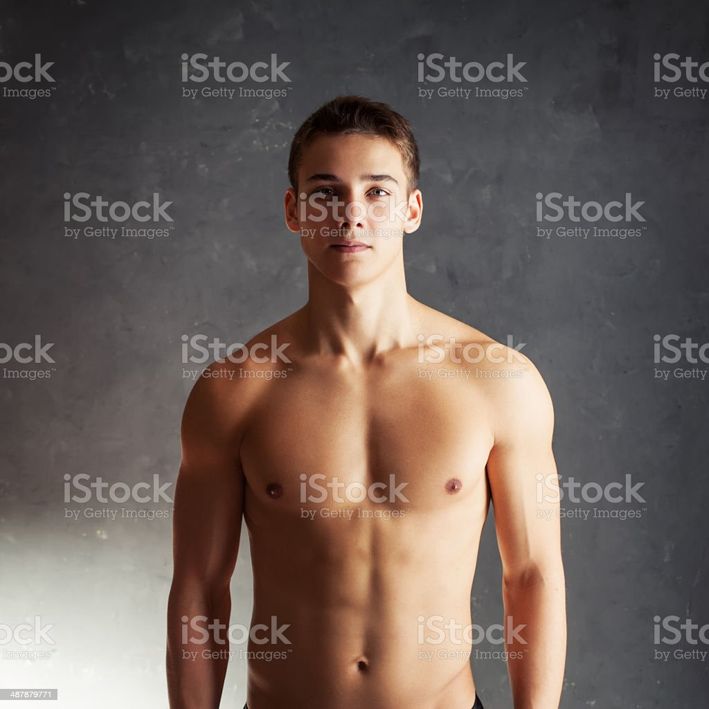 Portrait of muscular young man stock photo