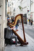 Paris - France - 24 October 2020 - Portrait of musician playing harp in the street