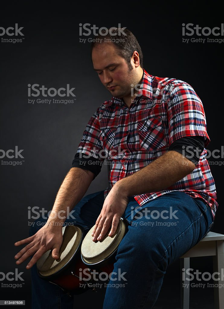 portrait of musician with bongo stock photo