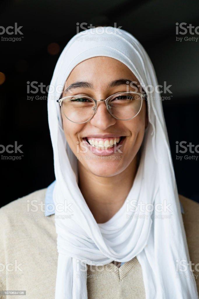 Portrait of muslim young woman wearing hijab. stock photo