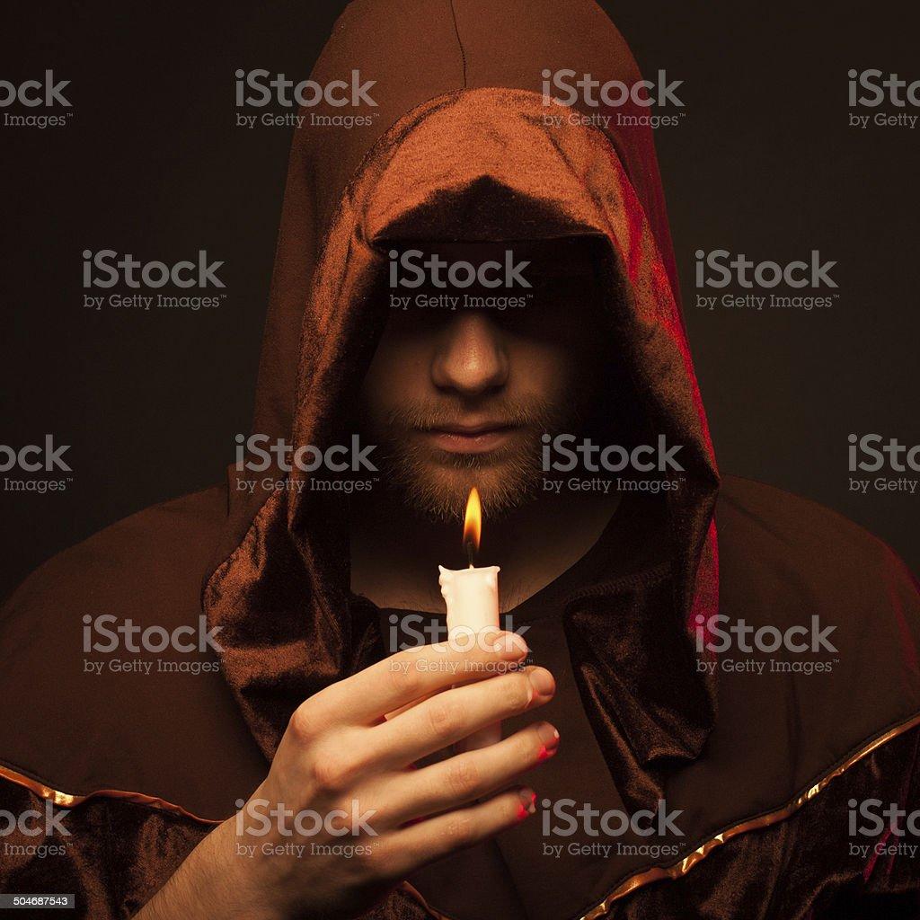 Portrait of mystery unrecognizable monk stock photo