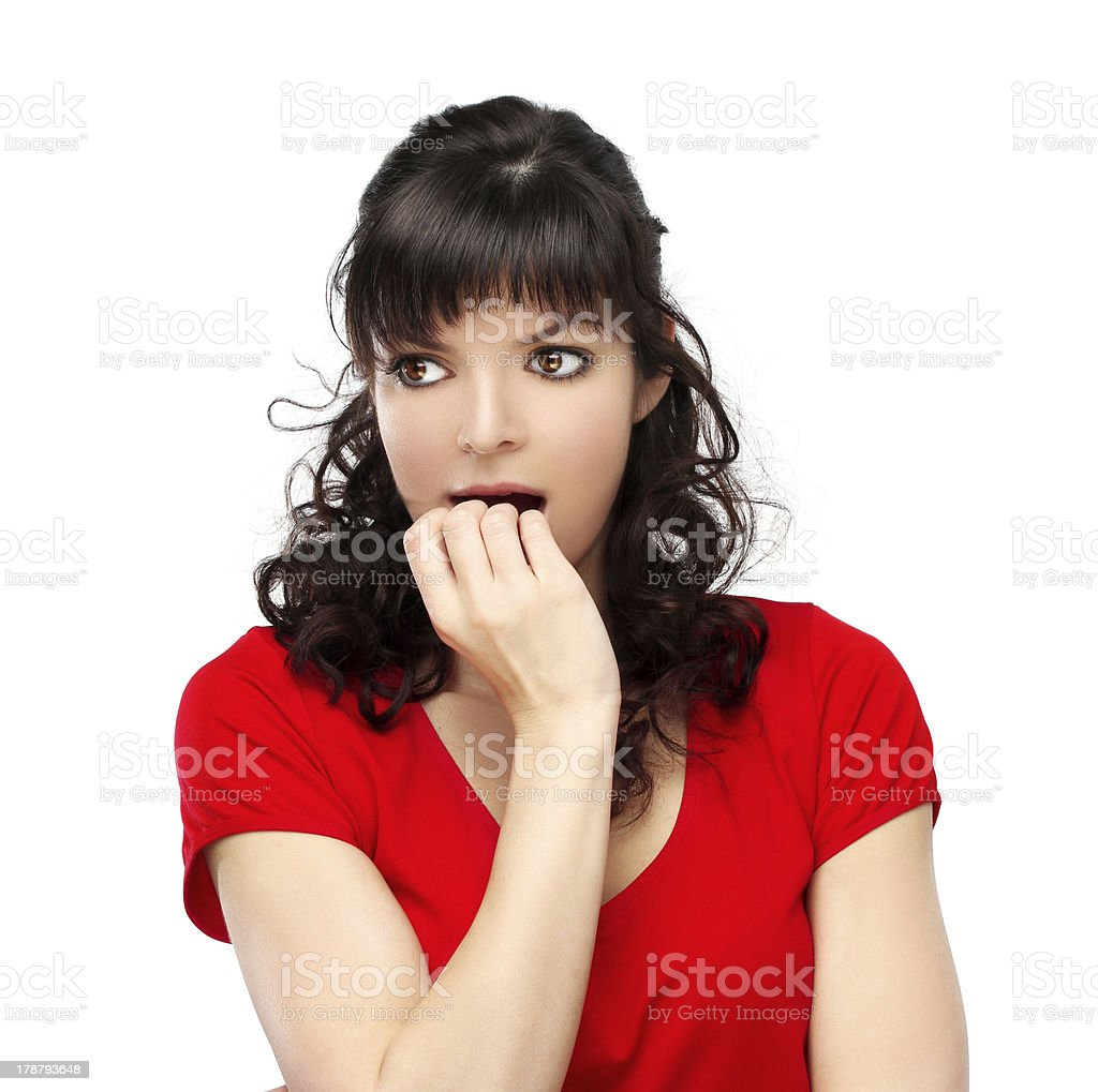 Portrait of nervous woman biting her nails.. White background. royalty-free stock photo