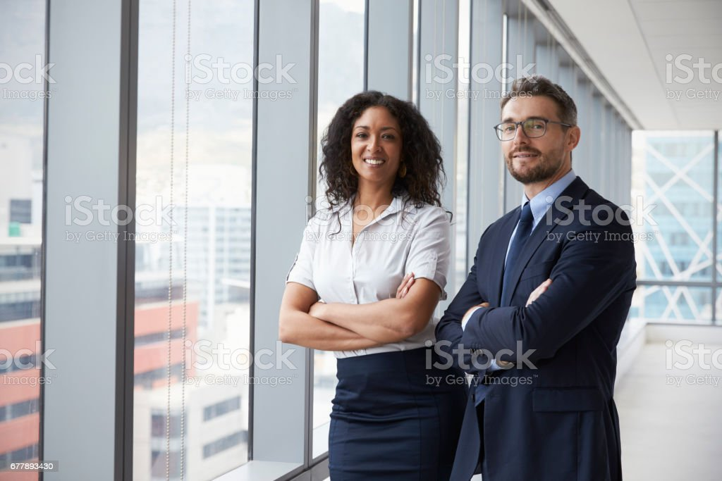 Portrait Of New Business Owners In Empty Office stock photo