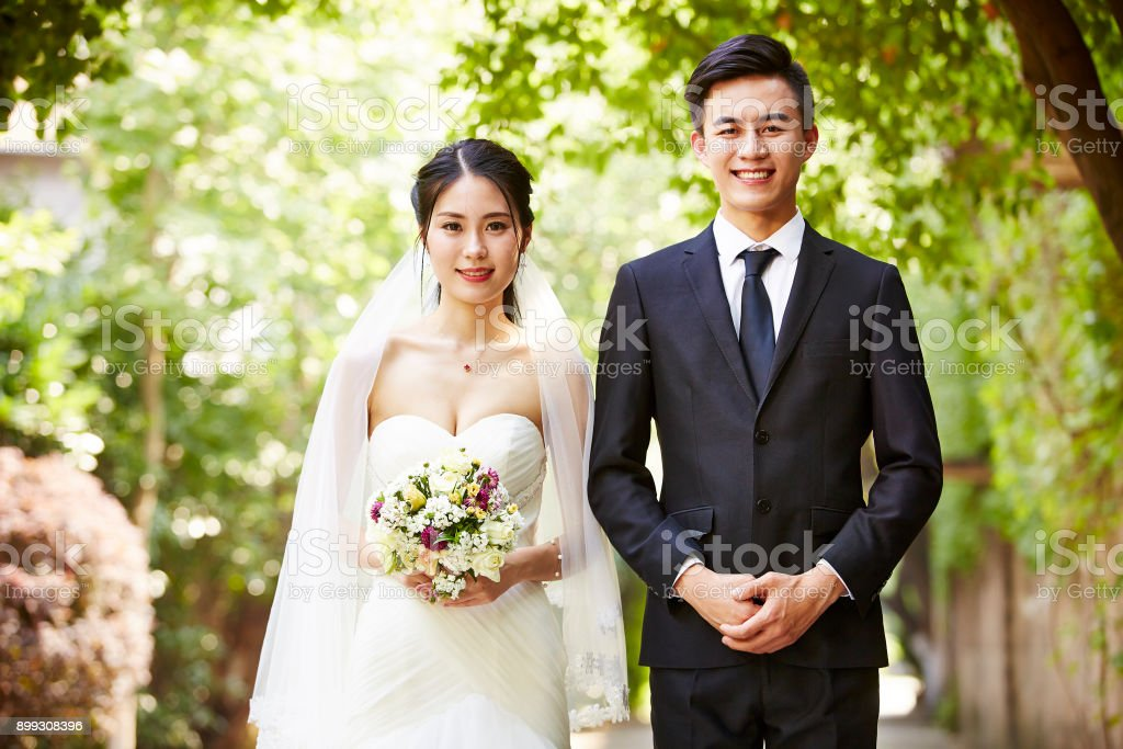 portrait of newlywed asian couple stock photo