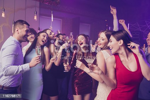Portrait of nice adorable elegant fascinating glamorous chic smart attractive cheerful, cheery positive dreamy glad ladies and guys having fun birthday rest relax nightlife at fogged lights nightclub
