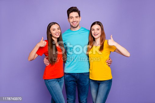Portrait of nice attractive lovely cheerful cheery content friendly guys wearing, colorful t-shirts jeans denim showing thumbup advice solution isolated over violet lilac background