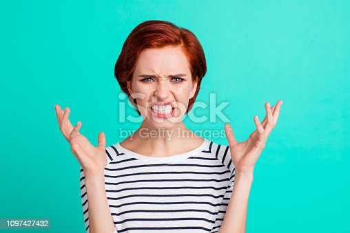Portrait of nice charming attractive mad distracted red-haired lady in striped pullover showing rage gesture isolated over bright vivid shine green turquoise background