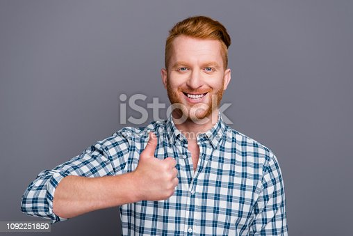 Portrait of nice cheerful cheery handsome attractive trendy man wearing checkered shirt showing thumbs-up symbol isolated over grey pastel background