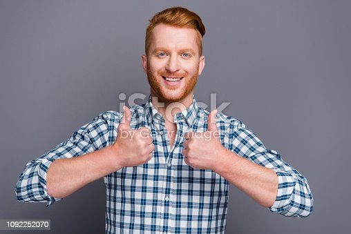 1092211952 istock photo Portrait of nice cheerful cheery positive handsome attractive trendy man wearing checkered shirt showing double thumbs-up isolated over grey pastel background 1092252070