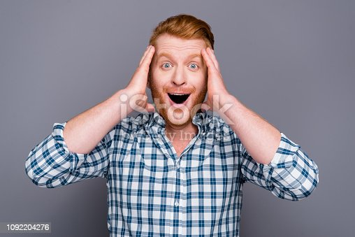1092211952 istock photo Portrait of nice cheerful cheery wondered handsome attractive trendy man wearing checkered shirt opened mouth prize sale discount isolated over grey pastel background 1092204276