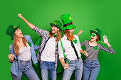 Portrait of nice crazy cool attractive cheerful ecstatic glad positive group guys girls eyeglasses eyewear costumes rejoicing having fun isolated over bright vivid shine background