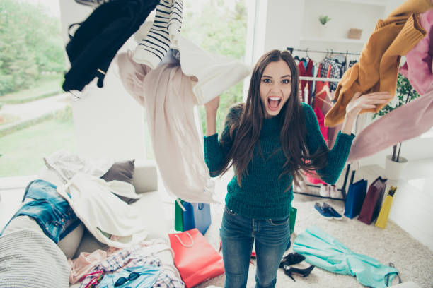 portrait of nice cute attractive charming pretty cheerful cheery positive girl student throwing many different new things day dream daydream in light white interior room - desarrumação imagens e fotografias de stock