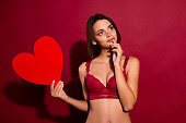 istock Portrait of nice cute sweet dreamy chic attractive lovely winsome girlfriend holding in hand large big heart healthy healthcare cardiology isolated over burgundy maroon background 1127553035