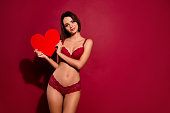 istock Portrait of nice cute sweet gorgeous attractive lovely  lady girlfriend holding in hands large big heart health healthy cardiology isolated over burgundy maroon background 1127553151