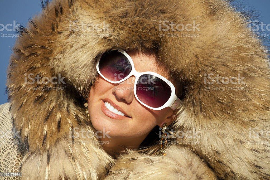 portrait of nice girl in fox fur stock photo