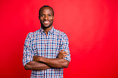 istock Portrait of nice handsome well-groomed attractive cheerful positive cheery guy wearing checked shirt isolated over bright vivid shine red background 1097434144