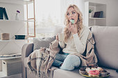 istock Portrait of nice lovely attractive funny hungry wavy-haired lady holding in hands cup eating large plate of tempting seductive sweets enjoying life in light interior room 1097333220