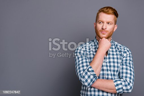 istock Portrait of nice minded handsome attractive businessman wearing checkered shirt thinking about strategy project start-up copy space isolated over grey pastel background 1092247642