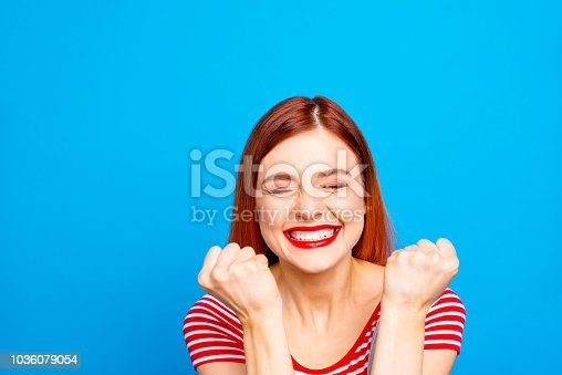 istock Portrait of nice vivid girlish red straight-haired happy smiling 1036079054
