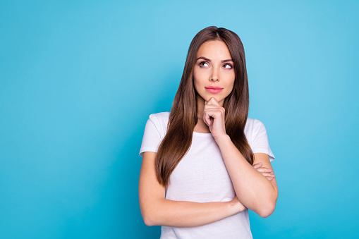 Portrait of nice-looking attractive lovely lovable feminine gorgeous fascinating straight-haired girlfriend thinking creating plan isolated over bright vivid shine blue green teal turquoise background