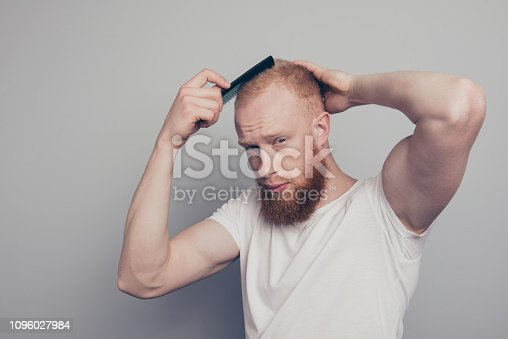 932956896istockphoto Portrait of nice-looking man stand isolated on light gray wall c 1096027984