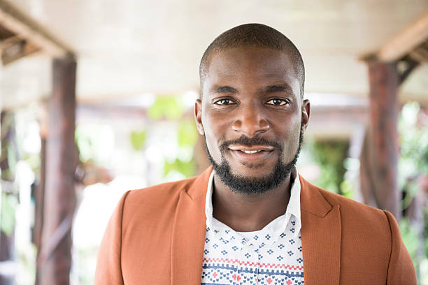 Portrait of Nigerian man with beard looking at camera stock photo