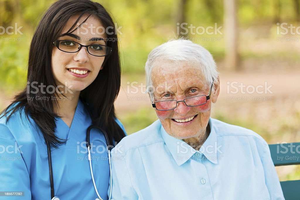 Portrait of Nurse and Elderly Patient royalty-free stock photo