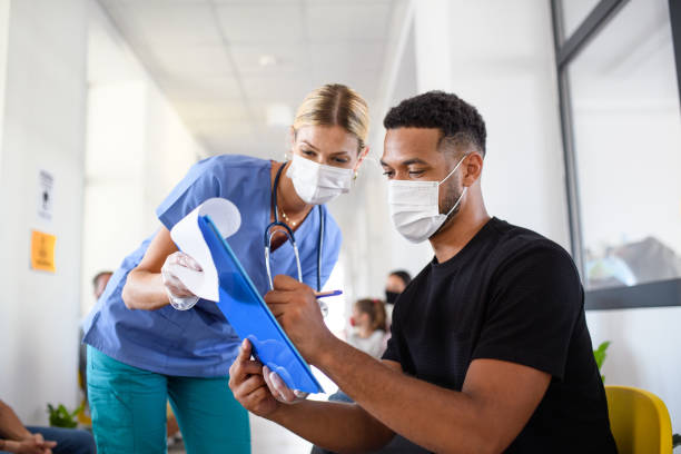Portrait of nurse and man with face masks, coronavirus, covid-19 and vaccination concept. stock photo