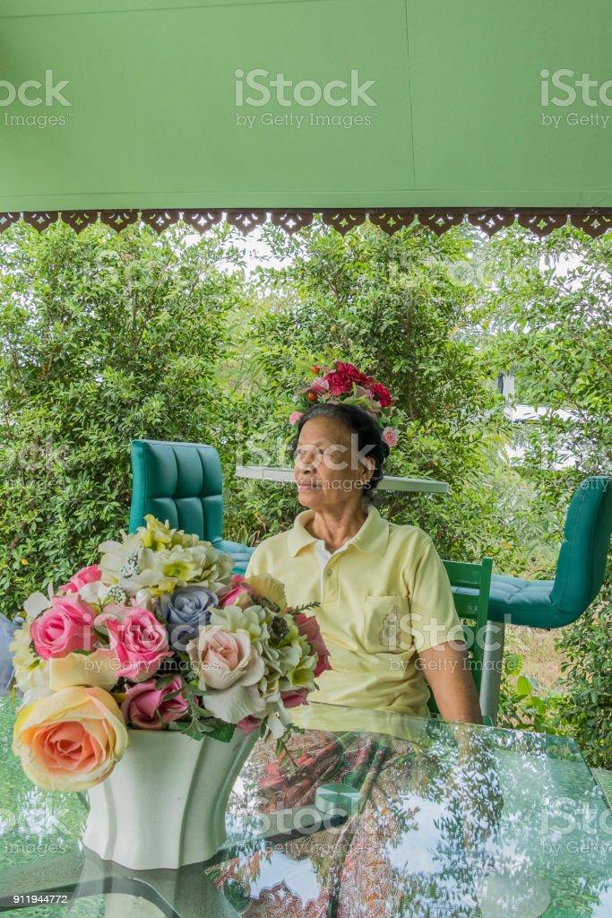 Phenomenal Portrait Of Old Asian Thai Woman Sitting On Chair That Download Free Architecture Designs Ferenbritishbridgeorg