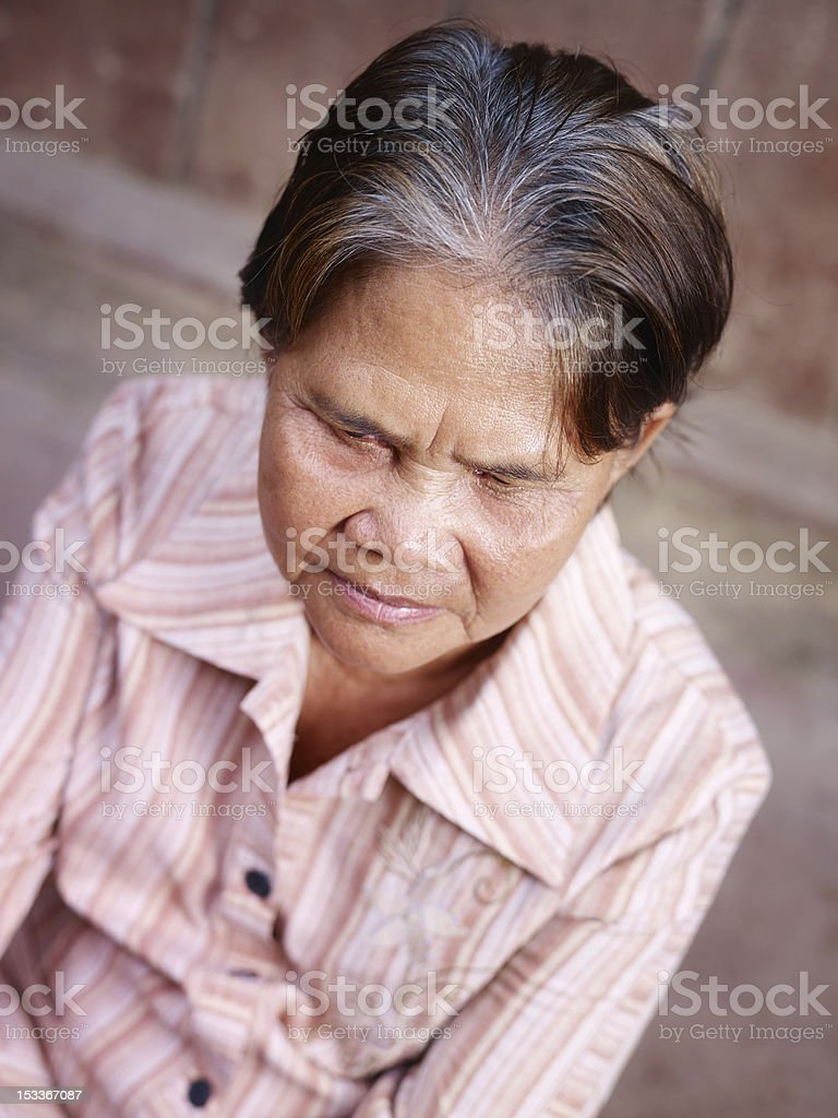 Portrait of old asian woman looking at camera royalty-free stock photo