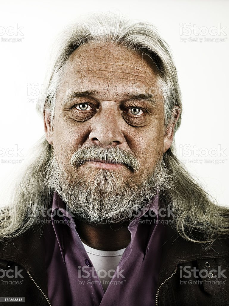 Portrait of old man with white long hair stock photo