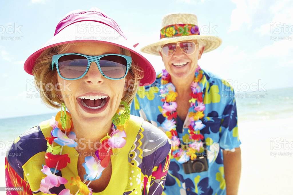 Portrait of older couple enjoying their retirement on the beach royalty-free stock photo