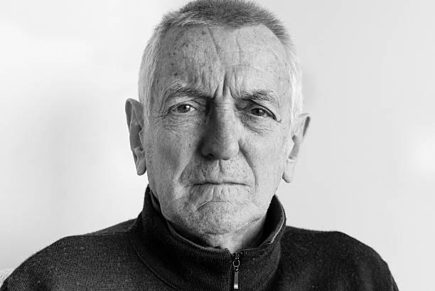 Portrait of older man (black and white) stock photo