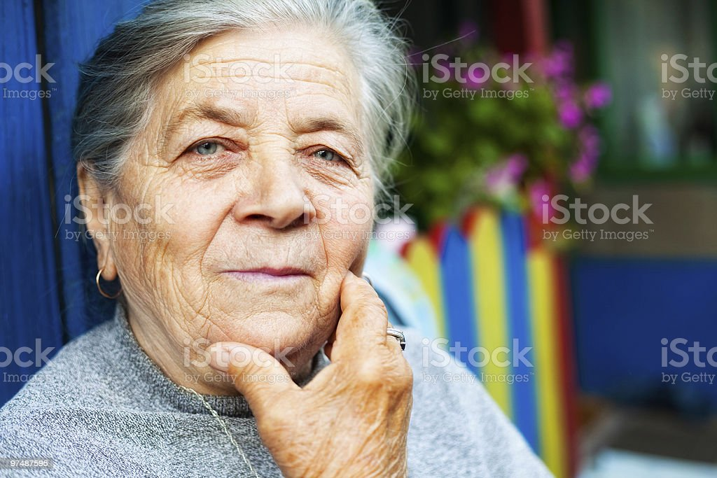 Portrait of one content old senior woman royalty-free stock photo