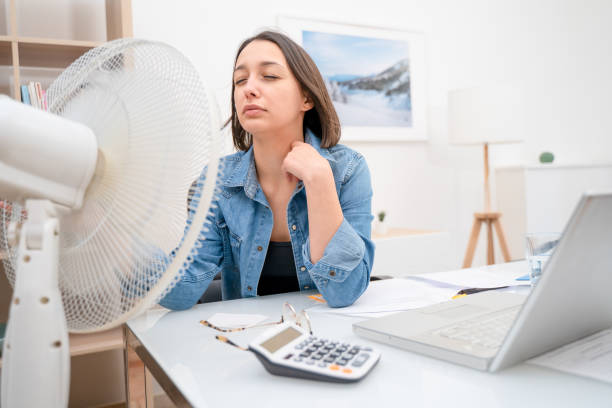 Portrait of one woman refreshing during summer heatwave stock photo