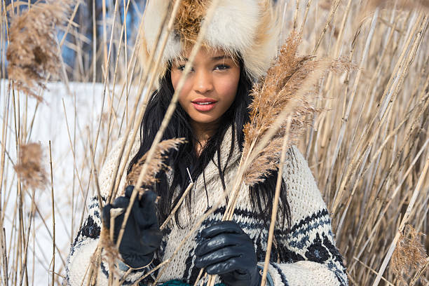 Portrait of one young woman in a meadow in winter stock photo